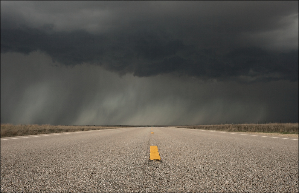 Dark rain curtain with imbedded hail crossing the road near Billings, Oklahoma off of Interstate 35.