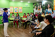 Dieters attend a class at the WeightWatchers center in Shanghai, China on 12 May 2010. An increasing number of Chinese people, especially those who live in cities, are becoming obese due to high caloric and protein diet, a problem that is almost unheard of just a generation ago.