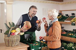Mature woman buying fruits and vegetables in the store, Bavaria, Germany