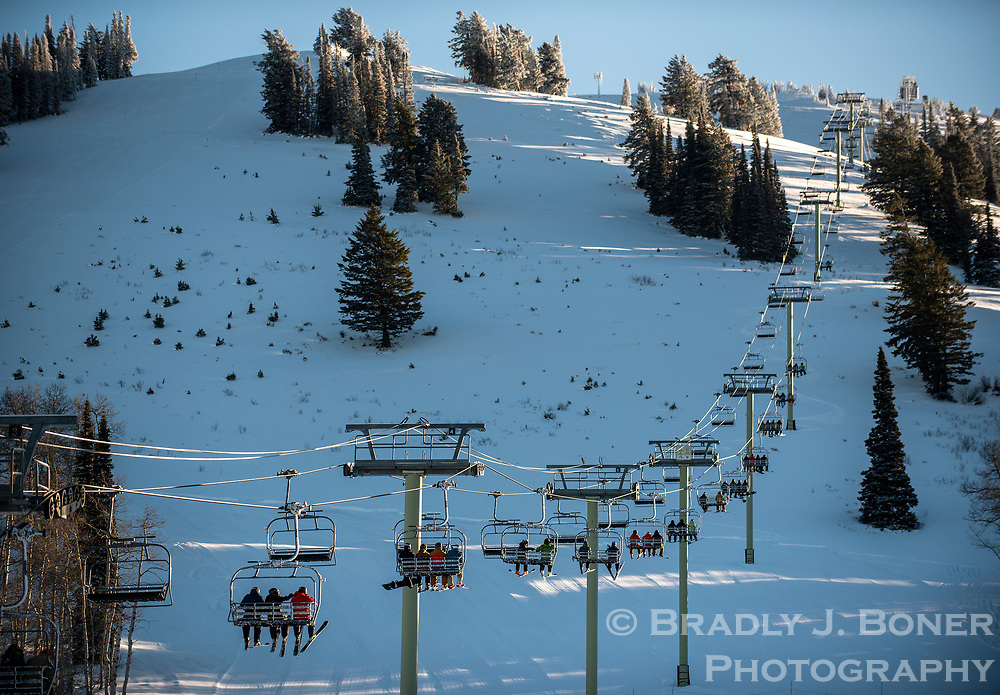 The first skiers of the 2020-21 ski season ride the Dreamcatcher Lift on Friday during Grand Targhee Resort's first day of operations at the west slope ski hill. Jackson Hole Mountain Resort is scheduled to open Thanksgiving Day while Snow King Mountain plans to begin spinning lifts on December 5.