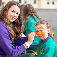 Aoibhin O'Callaghan from Knockanean NS paints Zoe Speakes face during the Fun Day for Jessies