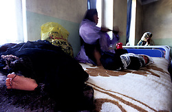 FAIZABAD PROVINCIAL HOSPITALl, 27 July 2005..A mother sits herself down with her two newborn babies.....According to United Nations Population Fund, Afghanistan has among the world?s highest rates of maternal mortality, and Badakhshan has the highest rates ever recorded anywhere in the world, with one mother dying in every 15 births. ....