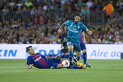 August 13, 2017 - Barcelona, Spain - Isco and Sergio Busquets during the match between FC Barcelona - Real Madrid, for the first leg of the Spanish Supercup, held at Camp Nou Stadium on 13th August 2017 in Barcelona, Spain. (Credit: Urbanandsport / NurPhoto) (Credit Image: © Urbanandsport/NurPhoto via ZUMA Press)