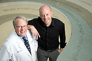 cancer researcher Kris Wood (black shirt) with Duke Cancer Center physician Joe Moore. Moore is treating Wood for cancer