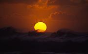Sunset behind waves, Hawaii<br />