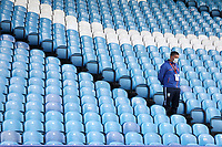 A member of the Sheffield Wednesday staff wearing PPE (personal protective equipment) looks out from empty stands<br /> <br /> Photographer Rich Linley/CameraSport<br /> <br /> The EFL Sky Bet Championship - Sheffield Wednesday v Nottingham Forest - Saturday 20th June 2020 - Hillsborough - Sheffield <br /> <br /> World Copyright © 2020 CameraSport. All rights reserved. 43 Linden Ave. Countesthorpe. Leicester. England. LE8 5PG - Tel: +44 (0) 116 277 4147 - admin@camerasport.com - www.camerasport.com