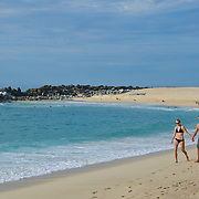 Couple walking by the ocean.<br /> Melia Cabo Real, Cabo San Lucas.<br /> Baja California Sur, Mexico.