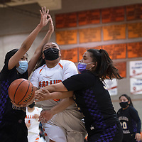 Gallup Bengal Hailey Long (40) drives to the basket as Kirtland Central Broncos Teghan Begay (22) and Keira Beall-Gleason (32) defend at Gallup High School in Gallup Friday evening.