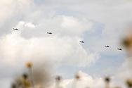 Mexican National Guard helicopters in a practice flight over Nextlalpan municipality. / Helicópteros de la Guardia Nacional mexicana en un sobrevuelan el municipio de Nextlalpan durante una práctica.