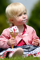 © Licensed to London News Pictures. 28/05/2016. Leeds UK. One year old Scarlet eats an ice cream in the bank holiday sunshine at Temple Newsam park in Leeds. (parental consent has been given). Photo credit: Andrew McCaren/LNP
