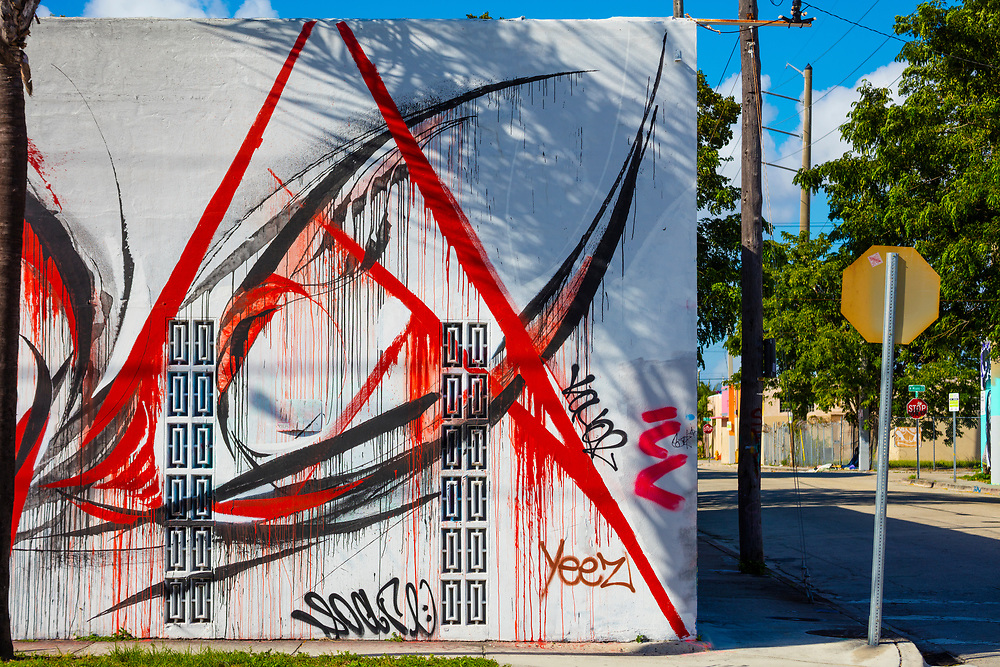 Slashing, red and black graffiti on a commercial building in Miami's Wynwood district