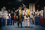 """James """"States"""" Manship, 60, left, dressed as George Washington and William Temple, 63, dressed as a minute man, walk through the HUB during day two of the Conservative Political Action Conference (CPAC) at the Gaylord National Resort & Convention Center in National Harbor, Md."""