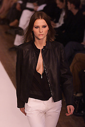 Nicole Farhi Spring/Summer 2001 London Fashion Week.Black leather jacket, black top, white trousers, September 28, 2000..Photo by Andrew Parsons/i-Images..