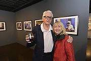"""Legendary photographer Harry Benson and St. Louis artist Peter Manion with their exhibitions -- Manion's """"Artificial Turf"""" and Benson's """"Kings & Queens"""" -- at the World Chess Hall of Fame Fall Exhibit Opening Reception on Friday, Oct. 5, 2018 in St. Louis. (Tim Vizer/AP Images for World Chess Hall of Fame)"""