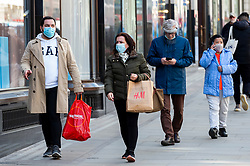 © Licensed to London News Pictures. 12/04/2021. LONDON, UK.  People carrying their shopping in Regent Street following the UK government's coronavirus roadmap out of lockdown which allowed non-essential shops to reopen today.  Photo credit: Stephen Chung/LNP
