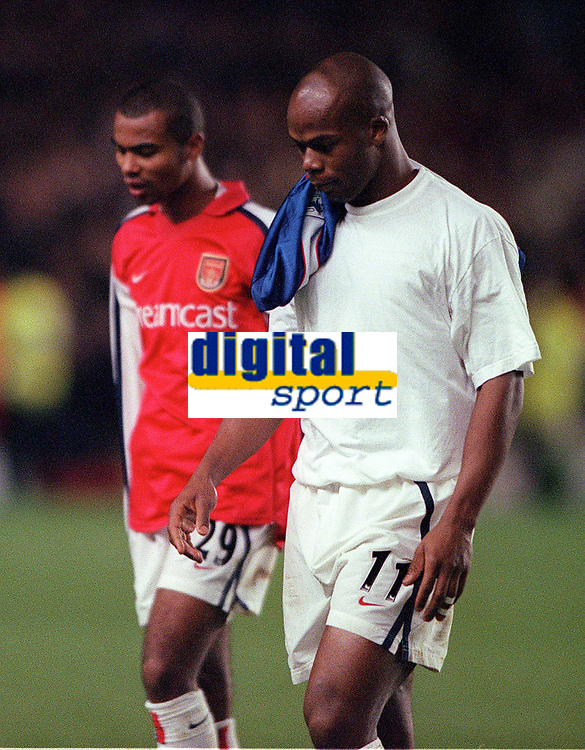 Dejected Arsenal players Sylvian Wiltord and Ashley Cole leave the pitch after the match. Arsenal 1:2 Ipswich Town, Worthington Cup, Third Round, 1/11/2000. Credit Colorsport / Stuart MacFarlane.
