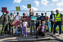 London, UK. 14th August, 2021. Southwark residents and campaigners protest alongside Peckham Green against plans by Southwark Council to develop it as public housing. Peckham Green, also known as Jocelyn Street Park, is a 1.4-acre public park off Peckham High Street, one of the most polluted roads in London, in a borough which is ranked fifth-worst in London and eighth-worst in the UK for easy access to green space.