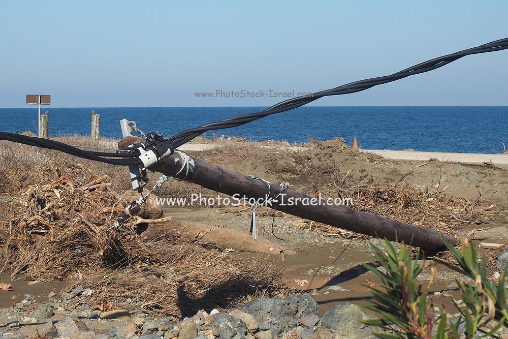 fallen telephone pole disrupting communication. Photographed on Samothrace Island, Greece