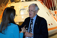 Garden City, New York, U.S. June 6, 2019. CHARLIE DUKE, Apollo 16 astronaut, is interviewed in front of the genuine Rockwell Command Module 002, Command and Service Module with splashdown parachute attached, during Cradle of Aviation Museum's Apollo Astronauts Press Conference during its day of events celebrating 50th Anniversary of Apollo 11.