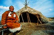 Chukchi woman with reindeer skin tent, Arctic Siberia