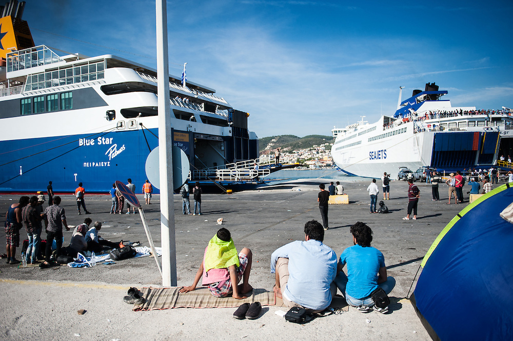 Refugees and migrants at the port of Mytiline waiting for the next available boat tat will take them to the Greek mainland.