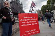 A female Brexiter with a red placard outside Houses of Parliament on the first day after summer recess on 3rd September 2019 in London in the United Kingdom. MPs return to Westminster for a Brexit shutdown that could result in a general election.