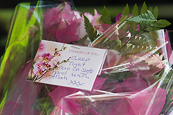 "© Licensed to London News Pictures . 22/05/2013 . Bolton , UK . Card left on a bunch of flowers brought to the Zakaria Mosque , where the service takes place . The card reads "" Sleep tight now in safe hand with Allah xxx "". Burial prayers for Baby Alia today (Wednesday 22nd May) whose body was discovered abandoned shortly before 4.55pm on Thursday March 14 in Ox Hey Lane , Lostock , near Bolton , by a man and woman out walking their dog . She was wrapped in clothes and a carrier back with a note requesting an Islamic burial . Police say the girl was born alive . They are yet to identify who her mother is . Photo credit : Joel Goodman/LNP"
