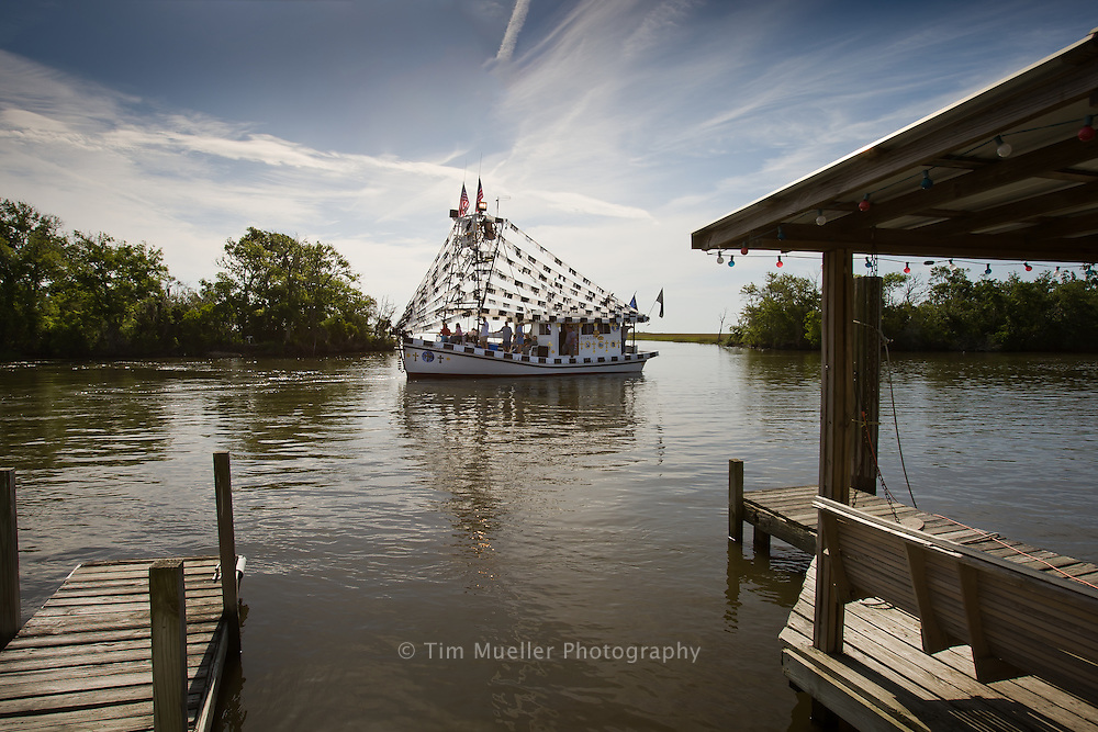 Phillip and Darlene Sevin of Chauvin, La. decorate their shrimp boat, Sidney Joseph, before the 2008 Boat Blessing in Chauvin, La.