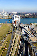 Nederland, Zuid-Holland, Rotterdam, 18-02-2015; westelijk toerit Botlektunnel onder de Oude Maas, gezien naar de nieuwe Botlekbrug  (in aanbouw). Links van de nieuwe brug de oude hefbrug die een file van vrachtverkeer veroorzaakt.<br /> Eastern entrance Botlektunnel under the Old Meuse and the new Botlek bridge (under construction). <br /> luchtfoto (toeslag op standard tarieven);<br /> aerial photo (additional fee required);<br /> copyright foto/photo Siebe Swart