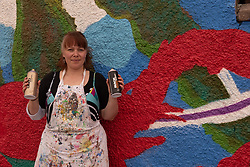 Local artist Dallas Henderson-Smith continues her work on a sea-themed mural on Portobello Prom. The mural, on the wall of the Toddlers' Hut nursery has been supported by Keep Porty Tidy and has replaced some unsightly grafitti. Pictured: Dallas Henderson-Smith <br /> <br /> <br /> © Jon Davey/ EEm