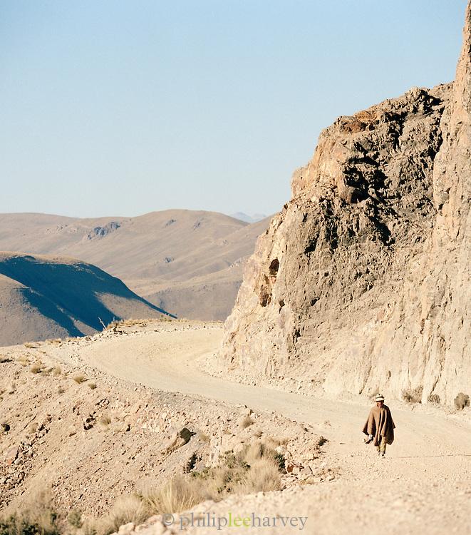 Man walking along a cliff road in Llallagua in the Potosi department, Bolivia
