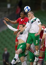 DUBLIN, REPUBLIC OF IRELAND - Friday, May 27, 2011: Wales' Daniel Gabbidon and Northern Ireland's Stuart Dallas and Colin Coates during the Carling Nations Cup match at the Aviva Stadium (Lansdowne Road). (Photo by David Rawcliffe/Propaganda)