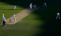 England's Joe Root bowls to Shaun Marsh during day two of the Ashes Test match at The Gabba, Brisbane.