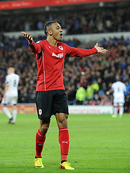 Cardiff City's Peter Odemwingie celebrates - Photo mandatory by-line: Joe Meredith/JMP - Tel: Mobile: 07966 386802 03/11/2013 - SPORT - FOOTBALL - The Cardiff City Stadium - Cardiff - Cardiff City v Swansea City - Barclays Premier League