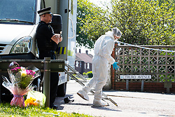 © Licensed to London News Pictures. 28/05/2018. Stockport, UK. Police , forensic examiners and flowers left at the scene outside The Salisbury Club on Truro Avenue in the Brinnington area of Stockport, Greater Manchester, where a car collided with pedestrians late last night, killing one man and injuring others.  A murder investigation has been launched. Police later recovered a black Audi A4 which fled the scene. Photo credit: Joel Goodman/LNP