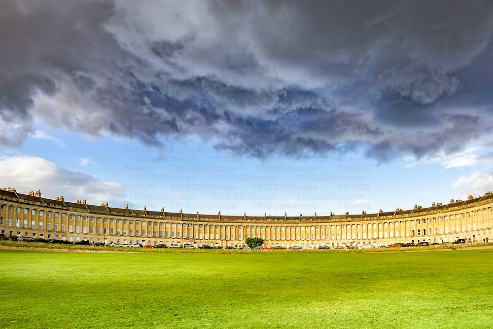 The Royal Crescent is a row of 30 terraced houses laid out in a sweeping crescent in the city of Bath, England. Designed by the architect John Wood, the Younger and built between 1767 and 1774, it is among the greatest examples of Georgian architecture to be found in the United Kingdom and is a Grade I listed building. Although some changes have been made to the various interiors over the years, the Georgian stone façade remains much as it was when it was first built.