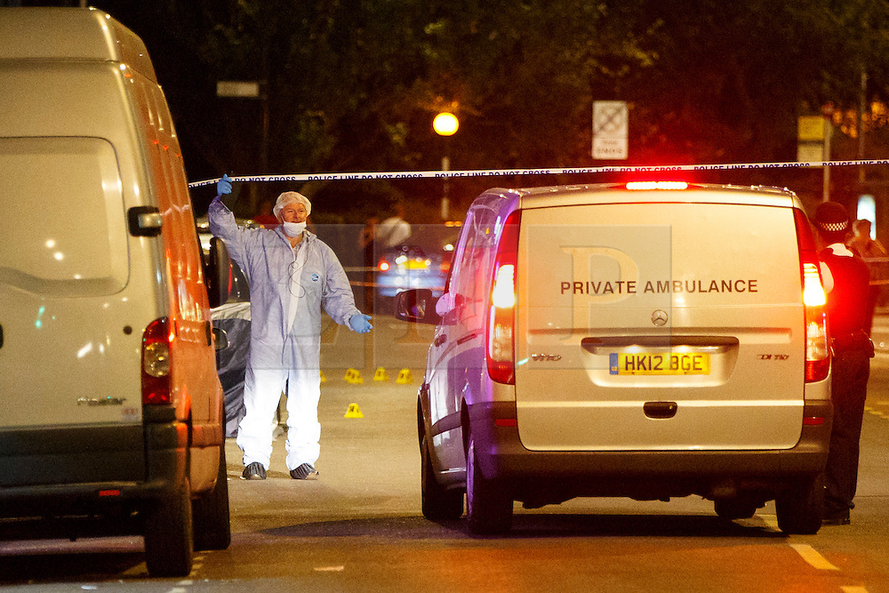 © Licensed to London News Pictures. 10/07/2015. London, UK. A private ambulance arrives at a crime scene on Lordship Lane in Wood Green, north London where a man has died and a woman has been taken to hospital following an apparent drive-by shooting on Friday, July 10, 2015. Photo credit: Tolga Akmen/LNP