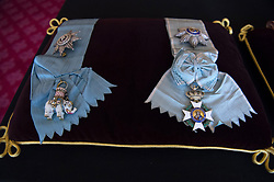 The Order of the Elephant (Denmark), and the Order of the Redeemer (Greece) sewn onto a cushion in St James's Palace, London. The cushions displaying medals and decorations conferred on the Duke of Edinburgh by the United Kingdom and other countries across the world, together with his Field Marshal's baton and Royal Air Force Wings, will be placed on the altar in St George's Chapel, in Windsor, ahead of his funeral on Saturday. Picture date: Tuesday April 13, 2021.