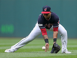 October 6, 2017 - Cleveland, OH, USA - Cleveland Indians second baseman Jose Ramirez bobbles a grounder by the New York Yankees' Greg Bird for an error in the first inning during Game 2 of the American League Division Series, Friday, Oct. 6, 2017, at Progressive Field in Cleveland. (Credit Image: © Phil Masturzo/TNS via ZUMA Wire)
