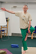 Prisoners and staff take part in a Yoga class run by the Prison Phoenix Trust. HMP Bullingdon, Oxfordshire.