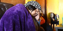 South Africa -Cape Town - 17 September 2020- Traumatised Nobongisa Mapoma the wife of Seargent Thobile Mapoma of the Harare Police Station who was shot and killed in his house minutes before he left for work.The man was in his car ready for duty when man stormed his yard and shot him, about 38 rounds were found on the scene.There are no clear details what might have caused this crime .Picture:Phando Jikelo/African News Agency(ANA)