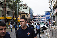 Turkish police guard the site of one of two car bombings in the Turkish border town with Syria, Reyhanli.