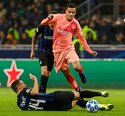 November 7, 2018 - Milan, Italy - Ivan Perisic of Inter Milan and Philippe Coutinho (top) of Barcelona vie for the ball during the Group B match of the UEFA Champions League between FC Internazionale and FC Barcelona on November 6, 2018 at San Siro Stadium in Milan, Italy. (Credit Image: © Mike Kireev/NurPhoto via ZUMA Press)