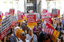 May 5, 2018 - London, England, United Kingdom - Protester hold signs reading 'Solidarity with the Windrush generation'' during a protest in support of the Windrush generation in London, United Kingdom on May 5, 2018. The Windrush generation are people who arrived in the UK after the Second World War from Caribbean countries at the invitation of the British government. It is now thought that an estimated 50,000 people of the Windrush generation face the risk of deportation if they never formalized their residency status and do not have the required documentation to prove it. (Credit Image: © Alex Cavendish/NurPhoto via ZUMA Press)