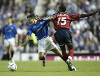 Fotball<br /> Kvalifisering til UEFA Champions League<br /> 25.08.2004<br /> Foto: SBI/Digitalsport<br /> NORWAY ONLY<br /> <br /> Glasgow Rangers v CSKA Moskva<br /> <br /> Rangers Nacho Novo cant get past Moscow's Chidi Odiah