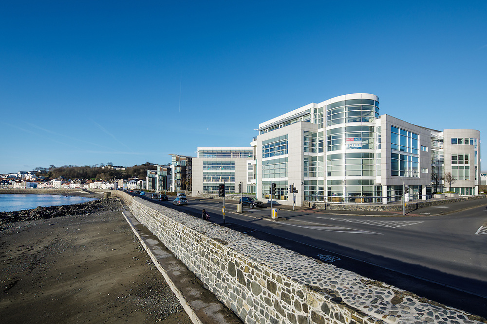 Beachfront banking and finance office buildings in the offshore finance district of Guernsey, Channel Islands