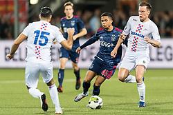 (L-R) Justin Kluivert of Ajax, Maarten Woudenberg od ASV De Dijk during the Second Round Dutch Cup match between De Dijk and Ajax Amsterdam at Kras stadium on October 25, 2017 in Volendam, The Netherlands