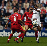 Photo. Jed Wee.<br /> Bolton Wanderers v Liverpool, Barclays Premiership, 29/08/2004.<br /> Bolton danagerman Jay Jay Okocha (R) is closely watched by Liverpool's Dietmar Hamann (C) and Steven Gerrard<br /> NORWAY ONLY