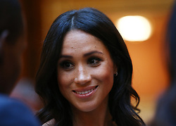 The Duchess of Sussex meets group of Queen's Young Leaders at a Buckingham Palace reception following the final Queen's Young Leaders Awards Ceremony.