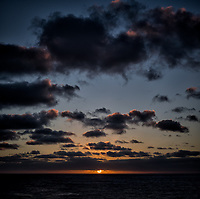 Panorama of the sun rising over the Pacific Ocean from the aft deck of the MV World Odyssey. Composite of two images taken with a Fuji X-T1 camera and 35 mm f/1.4 lens (ISO 200, 35 mm, f/11, 1/250 sec).
